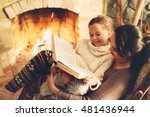 Mom With Child Reading Book An...