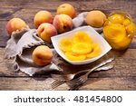 Bowl Of Canned Peaches With...