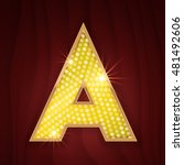 Gold light lamp bulb letter A.