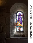 Small photo of EDINBURGH, SCOTLAND - CIRCA APRIL 2016 - Stained glass church window with St Columba on a boat, an irish abbot and missionary to the Scots, in a dark stone medieval chapel of St Margaret
