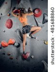 Sporty Female Climbing On An...