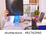young doctor at the table is... | Shutterstock . vector #481762960