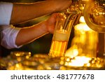 waiter pours beer from the tap | Shutterstock . vector #481777678