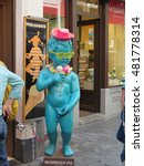 Small photo of Brussels, Belgium July 15 2016: Manneken Pis imitation advert for ice cream shop