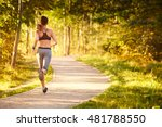 fit young woman running in park | Shutterstock . vector #481788550