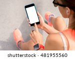Sports Woman Holding A Smart...