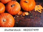Pumpkin With Pieces Over Wooden ...