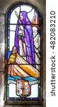 Small photo of EDINBURGH, SCOTLAND - CIRCA APRIL 2016 - Stained glass church window with St Columba on a boat, an irish abbot and missionary to the Scots