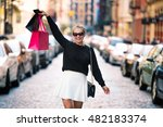 happy exited woman walking with ... | Shutterstock . vector #482183374
