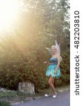 Small photo of Tinker Bell. Girl dressed as a fairy tale of Peter Pan