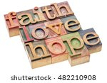 Small photo of biblical, spiritual or metaphysical reminder - faith, hope and love - word abstract in letterpress wood type blocks, stained by colorful inks, isolated on white