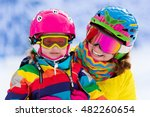 mother and little child skiing... | Shutterstock . vector #482260654