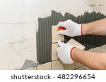 worker sets  tiles on the wall... | Shutterstock . vector #482296654