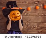Stock photo happy halloween cute little witch with a pumpkin 482296996