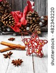 Small photo of Christmas decoration on the background of the Christmas wreath with pine cones