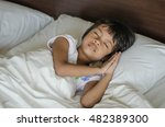 asian child happy in sleep time | Shutterstock . vector #482389300