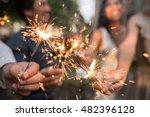 hands of people holding glowing ...   Shutterstock . vector #482396128