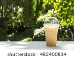 Ice Coffee In Plastic Cup At...