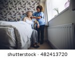 home caregiver helping a senior ... | Shutterstock . vector #482413720