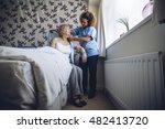 home caregiver helping a senior ... | Shutterstock . vector #482413720