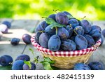 Blue And Violet Plums In The...