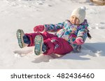 Child Is Lying On The Snow And...