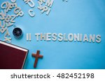 Small photo of Blue background with the Bible book of 2 Thessalonians