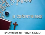 Small photo of Blue background with the Bible book of 2 Corinthians