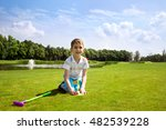 little boy golfer with his... | Shutterstock . vector #482539228