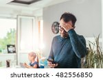worried father looking at smart ... | Shutterstock . vector #482556850