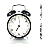 Small photo of Alarm Clock isolated on white, in black and white, showing seven o'clock.