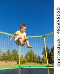 little boy jumping on a... | Shutterstock . vector #482698030