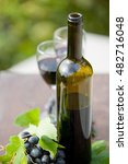 wine bottle and grapes on... | Shutterstock . vector #482716048