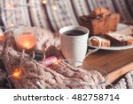 cup of black tea with cake and... | Shutterstock . vector #482758714