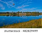 Tranquil mirror image Pagosa Springs Colorado hot air balloons in the sky next to pond