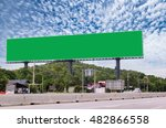 Small photo of Blank billboard for new advertisement beside the road under the blue sky, advertise concept