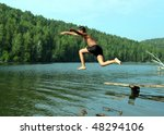summer vacations - boy jumping in lake - stock photo