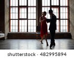 woman in dress and man in black ... | Shutterstock . vector #482995894
