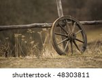 Old Wagon Wheel Near The Fence