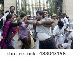 Small photo of Kolkata Police officer detain a Socialist Unity Center of India (Communist) activist in front of Governor House during a protest agitation on September 01, 2016 in Calcutta, India.
