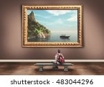 Stock photo young man with a backpack admiring a beautiful paint of a landscape in a museum 483044296