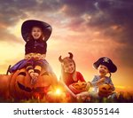 Stock photo happy brother and two sisters on halloween funny kids in carnival costumes outdoors cheerful 483055144