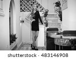 the charming lady stands near... | Shutterstock . vector #483146908