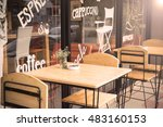 Stock photo selective focus of table of coffee shop outside view with vintage color tone 483160153