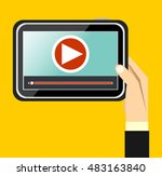hand holding tablet with video...