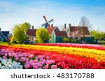 Small photo of Landscape with tulips, traditional dutch windmills and houses near the canal in Zaanse Schans, Netherlands, Europe