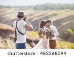 a wedding photographer takes... | Shutterstock . vector #483268294