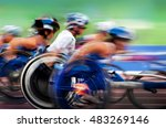 Small photo of finishing spurt Paralympic wheelchair in motion at the stadium