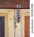 iron door bolt on wooden door | Shutterstock . vector #483282988