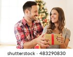 man giving a christmas present... | Shutterstock . vector #483290830